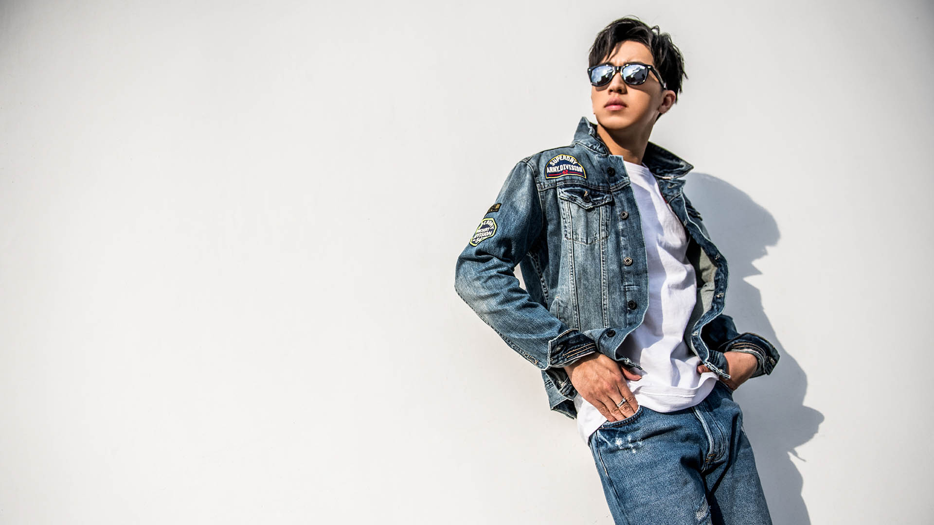 male-in-denim-leaning-against-wall.jpg